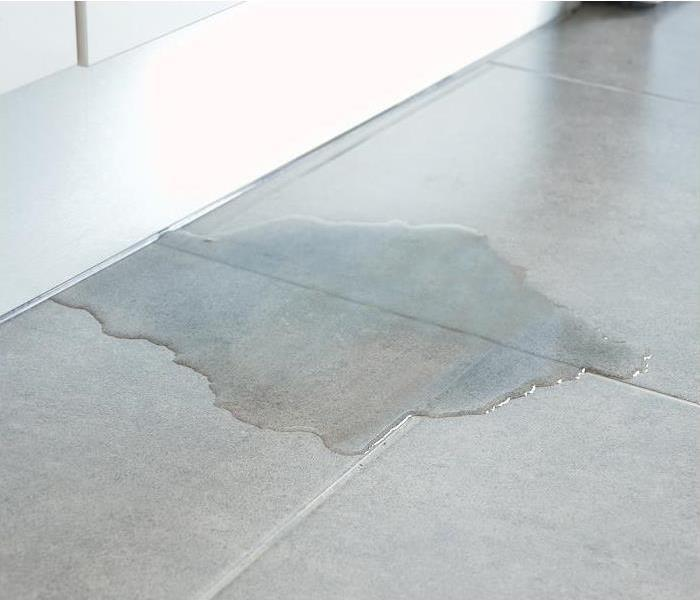 water damage all over a kitchen floor