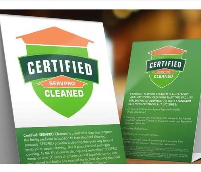 Certified: SERVPRO Cleaned table tents on a white background